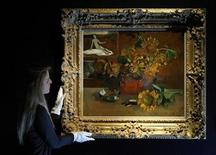 """<p>A Christie's employee poses with Paul Gauguin's """"Nature morte a 'L'esperence'"""" at Christie's auction house in London February 4, 2011. REUTERS/Luke MacGregor</p>"""