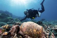 <p>Maritime archaeologist Dr. Kelly Gleason with the Papahanaumokuakea Marine National Monument is shown with a ginger jar from the 19th-century shipwrecked whaling ship Two Brothers in this publicity photo released to Reuters February 11, 2011. REUTERS/Greg McFall/NOAA FOR EDITORIAL USE ONLY. NOT FOR SALE FOR MARKETING OR ADVERTISING CAMPAIGNS. THIS IMAGE HAS BEEN SUPPLIED BY A THIRD PARTY. IT IS DISTRIBUTED, EXACTLY AS RECEIVED BY REUTERS, AS A SERVICE TO CLIENTS</p>