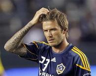 <p>David Beckham do Los Angeles Galaxy durante jogo contra o Columbus Crew em Carson, na Califórnia. Um juiz norte-americano recusou um processo aberto pelo jogador contra uma revista, no qual solicitava o pagamento de uma indenização por difamação, após uma reportagem afirmando que ele havia dormido com uma garota de programa. 11/09/2011 REUTERS/Lucy Nicholson</p>