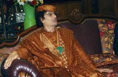 <p>Libyan leader Muammar Gaddafi attends a meeting with Benin President Yayi Boni in Cotonou, June 17, 2008. REUTERS/Charles Tossou</p>
