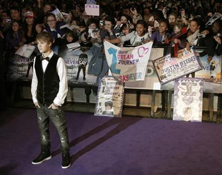 Canadian singer Justin Bieber poses for photographers as he arrives for the premiere of the film ''Justin Bieber: Never Say Never'', at the O2 Arena in London February 16, 2011. REUTERS/Luke MacGregor