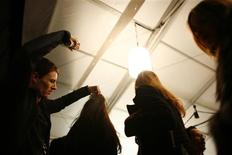 <p>A stylist applies some last-minute hairspray to a model before the Tommy Hilfiger Fall/Winter 2011 collection show during New York Fashion Week February 13, 2011. REUTERS/Eric Thayer</p>