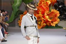 <p>British designer John Galliano appears at the end of his Fall/Winter 2010-2011 Haute Couture fashion show for French fashion house Dior in Paris in this July 5, 2010 file picture. REUTERS/Benoit Tessier</p>