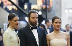"""<p>Giorgos Lanthimos (C), director of the Greek film """"Dogtooth,"""" arrives at the 83rd Academy Awards with his girlfriend Ariane Labed (L) and one of the film's actress Aggeliki Papoulia in Hollywood, California, February 27, 2011. REUTERS/Mario Anzuoni</p>"""