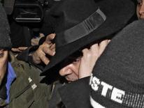 <p>Fashion designer John Galliano is surrounded by policemen as he leaves a police station in Paris, February 28, 2011. REUTERS/Jacky Naegelen</p>