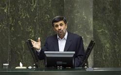 <p>EDITORS' NOTE: Reuters and other foreign media are subject to Iranian restrictions on leaving the office to report, film or take pictures in Tehran. Iran's President Mahmoud Ahmadinejad speaks to lawmakers in parliament in Tehran February 20, 2011. REUTERS/Raheb Homavandi</p>