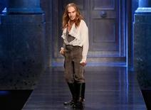 <p>British designer John Galliano appears at the end of his Fall/Winter 2010/11 women's ready-to-wear fashion show for French fashion house Dior during Paris Fashion Week on March 5, 2010. REUTERS/Benoit Tessier</p>