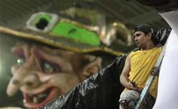 <p>A worker stands next to a carnival float at Grande-Rio Samba School in Rio de Janeiro March 1, 2011. The Rio de Janeiros's Carnival parade will held March 5-6. REUTERS/Ricardo Moraes</p>
