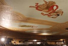 <p>Specialists on scaffolding work on the finishing of the ceiling of the main hall in the Bolshoi Theatre in Moscow March 1, 2011. REUTERS/Denis Sinyakov</p>