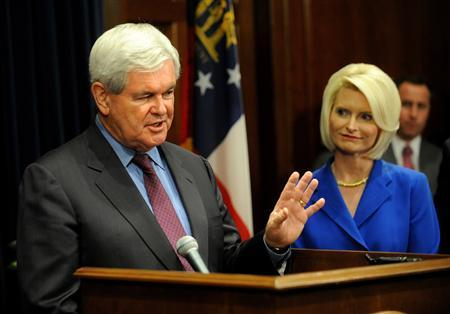 Former House Speaker Newt Gingrich speaks during a press conference as his wife, Callista Gingrich, looks on in Atlanta, Georgia, March 3, 2011. Gingrich on Thursday edged toward becoming the first big-name Republican to challenge President Barack Obama in the 2012 election. REUTERS/Johnny Crawford/Atlanta Journal-Constitution THIS IMAGE HAS BEEN SUPPLIED BY A THIRD PARTY. IT IS DISTRIBUTED, EXACTLY AS RECEIVED BY REUTERS, AS A SERVICE TO CLIENTS