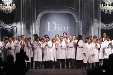 <p>Dior staff applauds on the catwalk at the end of British designer John Galliano's Fall-Winter 2011/2012 women's ready-to-wear fashion collection for French fashion house Dior during Paris Fashion Week March 4, 2011. REUTERS/Benoit Tessier</p>