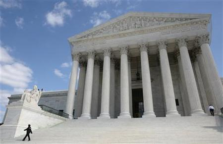 Security guards walk the steps of the Supreme Court in Washington in this October 1, 2010 file photo. REUTERS/Larry Downing