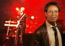 """<p>British singer Cliff Richard poses for photographers with his band """"Cliff Richard and The Shadows"""" before meeting fans at a music store in London November 30, 2009. REUTERS/Luke MacGregor</p>"""
