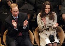 <p>Britain's Prince William and his fiancee, Kate Middleton, applaud as they watch a play at the Youth Action Northern Ireland Centre, in Belfast, Northern Ireland March 8, 2011. The couple are visiting Northern Ireland for the first time. REUTERS/Phil Noble</p>