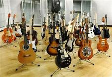 <p>Guitars belonging to British music icon Eric Clapton are displayed at the Bonhams auction house in New York March 4, 2011. More than 70 guitars belonging to Clapton will go on the auction block in New York next week to raise money for his drug and alcohol treatment center in the Caribbean. REUTERS/Brendan McDermid</p>