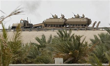 Armoured personnel carriers are transported on the flyover near the Bahrain Saudi bridge in Manama March 15, 2011. REUTERS/Hamad I Mohammed