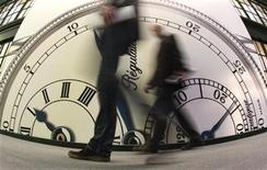 <p>Visitors walk past the Chronoswiss showcase at Baselworld fair in Basel March 24, 2011. REUTERS/Christian Hartmann</p>