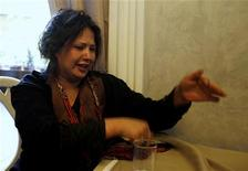 <p>Libyan woman Eman al-Obaidi gestures as she cries at a hotel in Tripoli March 26, 2011. The weeping Libyan woman made a desperate plea for help on Saturday, slipping into the Tripoli hotel full of foreign journalists to show bruises and scars she said had been inflicted on her by Muammar Gaddafi's militiamen. As reporters gathered to hear her story, security guards grabbed the woman, bundled her into a car and drove her away following a brawl in which several journalists were beaten. REUTERS/Zohra Bensemra</p>