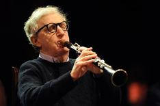 <p>U.S. film director Woody Allen plays the clarinet during a concert with The New Orleans Jazz Band at the inauguration ceremony of the Niemeyer Center in Aviles, north of Spain, March 25, 2011. REUTERS/Eloy Alonso</p>