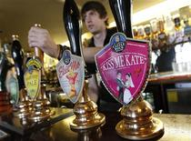 """<p>A pump clip showing the """"Kiss me Kate"""" ale at the Swan in the Rushes pub, in Loughborough, March 28, 2011. REUTERS/Darren Staples</p>"""