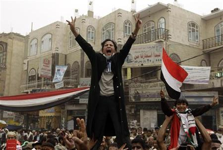Anti-government protesters shout slogans during a rally to demand the ouster of Yemen's President Ali Abdullah Saleh outside Sanaa University, March 28, 2011. REUTERS/Ammar Awad