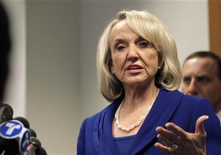 Arizona Governor Jan Brewer speaks at a news conference in San Francisco, California in this November 1, 2010 file photo. REUTERS/Robert Galbraith