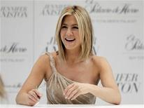 """<p>Actress Jennifer Aniston reacts during an autograph-signing event as part of promotional activities for her fragrance """"Jennifer Aniston"""" in Mexico City March 10, 2011. REUTERS/Henry Romero</p>"""