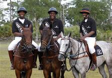 <p>(L-R) Kareem Rosser, Brandon Rease and Daymar Rosser pose before a polo skills competition in West Palm Beach, Florida March 29, 2011. REUTERS/Joe Skipper</p>