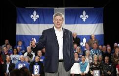 <p>Conservative leader and Prime Minister Stephen Harper speaks during a campaign rally in Saint-Agapit, Quebec April 5, 2011. REUTERS/Chris Wattie</p>