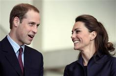 <p>Britain's Prince William speaks, watched by his fiancee Kate Middleton at the Darwen Aldridge Community Academy (DACA), in Darwen, northern England April 11, 2011. A large crowd of well-wishers braved a downpour in northern England on Monday to cheer Prince William and Kate Middleton as they took part in their final official engagement before their wedding. REUTERS/Adrian Dennis/Pool</p>