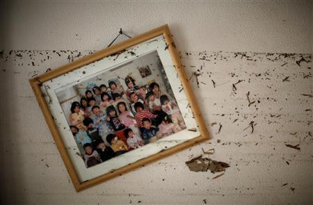 A picture frame and water marks are seen over the wall of a kindergarten destroyed by the earthquake and tsunami in Ishinomaki, April 7, 2011. REUTERS/Carlos Barria