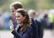 <p>Britain's Prince William (L) and his fiancee Kate Middleton visit Witton Country Park in Darwen, northern England April 11, 2011. REUTERS/Darren Staples</p>