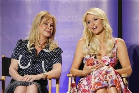 Paris Hilton (R) and her mother Kathy Hilton attend the Oxygen panel for the television series ''The World According to Paris'' during the Television Critics Association summer press tour in Pasadena, California April 15, 2011. REUTERS/Mario Anzuoni