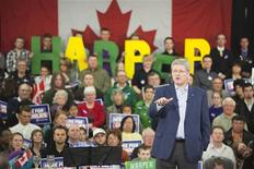 <p>Prime Minister Stephen Harper talks with supporters as part of his election campaign tour in Saskatoon April 15, 2011. REUTERS/David Stobbe</p>
