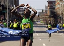 <p>Caroline Kilel of Kenya crosses the finish line to win the women's division of the 2011 Boston Marathon in Boston, Massachusetts April 18, 2011. REUTERS/Brian Snyder</p>