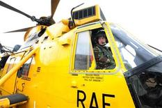 <p>Britain's Prince William sits at the controls of a Sea King helicopter during a training exercise at Holyhead Mountain, in Wales March 31, 2011. REUTERS/John Stillwell/Pool</p>