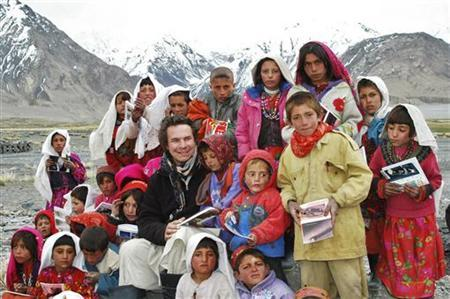 Greg Mortenson poses with Sitara ''Star'' schoolchildren in Wakhan, northeastern Afghanistan in this undated handout photograph released to Reuters March 11, 2009. REUTERS/Central Asia Institute/Handout