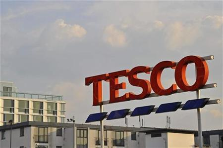 Branding for a Tesco store is seen in west London April 19, 2011. REUTERS/Toby Melville