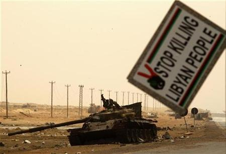A Gaddafi forces tank, destroyed by NATO air strikes, is seen on the road between Ajdabiyah and Brega near the western gate of Ajdabiyah April 26, 2011. REUTERS/Yannis Behrakis