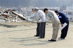 <p>Japanese Emperor Akihito (L) and Empress Michiko (2nd L) pray for earthquake and tsunami victims as they stand at the playground of Isatomae Elementary School, in the disaster-affected area in Minamisanriku town, Miyagi Prefecture April 27, 2011. Emperor Akihito and Empress Michiko paid their first visit to the northeastern Japan on Wednesday since the March 11 earthquake and tsunami devastated the Tohoku region. Minamisanriku town mayor Jin Sato (R) and Miyagi Governor Yoshihiro Murai are seen behind them. REUTERS/Toru Yamanaka/Pool</p>