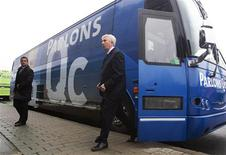<p>Bloc Quebecois leader Gilles Duceppe exits his bus for a press conference following a campaign stop in Montreal, April 26, 2011. Canadians will go to the polls in a federal election on May 2. REUTERS/Christinne Muschi</p>
