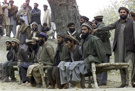 Captured Afghan al Qaeda members sit on a bench as they are presented to the media in Tora Bora, in this file picture taken December 17, 2001. Al Qaeda leader Osama bin Laden was killed May 1, 2011 in a firefight with U.S. forces in Pakistan and his body was recovered, President Barack Obama said on Sunday. ''Justice has been done,'' Obama said in a dramatic, late-night White House speech announcing the death of the elusive mastermind of the Sept. 11, 2001, attacks on New York and Washington that killed nearly 3,000 people. Bin Laden had been hunted since he eluded U.S. soldiers and Afghan militia forces in a large-scale assault on the Tora Bora mountains of Afghanistan close to the Pakistan frontier in 2001. REUTERS/Erik de Castro