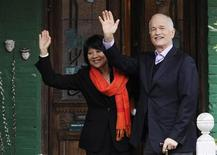 <p>New Democratic Party (NDP) leader Jack Layton waves with his wife and Trinity-Spadina candidate Olivia Chow (L) from the front porch of their home after casting their Federal Election ballots in Toronto, May 2, 2011. REUTERS/Mark Blinch</p>