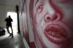 "<p>A portrait of disgraced official Lin Qingle, former vice general manager of Beijing Urban Construction Group Company, hangs on a wall with other portraits for Chinese artist and film-maker Zhang Bingjian's ""Hall of Fame"" project in his studio in Beijing April 22, 2011. REUTERS/Jason Lee</p>"