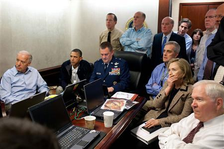 President Obama and Vice President Joe Biden, along with members of the national security team, receive an update on the mission against Osama bin Laden in the Situation Room of the White House, May 1, 2011. Also pictured are Secretary of State Hillary Clinton (2nd R) and Defense Secretary Robert Gates (R). Please note: A classified document seen in this photograph has been obscured at source. Picture taken May 1, 2011. REUTERS/White House/Pete Souza