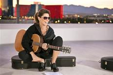 "<p>Canadian singer Shania Twain is pictured on a rooftop in Las Vegas with her guitar in this March 16, 2011 publicity photograph promoting her upcoming docu-series, ""Why Not? With Shania Twain"". The series premieres May 8, 2011 on Winfrey's OWN cable network. REUTERS/OWN/Handout</p>"