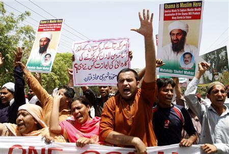 Demonstrators hold posters of al Qaeda leader Osama bin Laden, who was killed on Monday in a U.S. special forces assault on a Pakistani compound, as they chant anti-U.S. slogans during a rally of more than 100 people in Multan May 4, 2011. REUTERS/Stringer