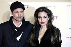 "<p>Actors Angelina Jolie (R) and Brad Pitt pose for pictures as they arrive for the Italian premiere of the movie ""The Tourist"" in Rome, December 15, 2010. REUTERS/Alessia Pierdomenico</p>"