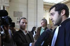 <p>Aurelien Hamelle (R), lawyer representing fashion designer John Galliano, speaks to the media at the courts in Paris May 12, 2011. REUTERS/Jacky Naegelen</p>