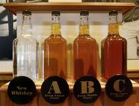 <p>Bottles showing the barrel aging process are seen at the Jack Daniel's distillery in Lynchburg, Tennessee May 10, 2011. REUTERS/ Martinne Geller</p>
